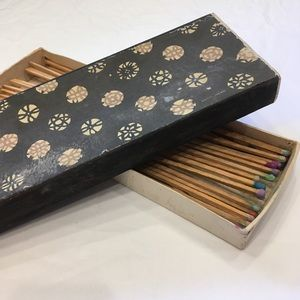 Vintage oversized matches in patterned box.